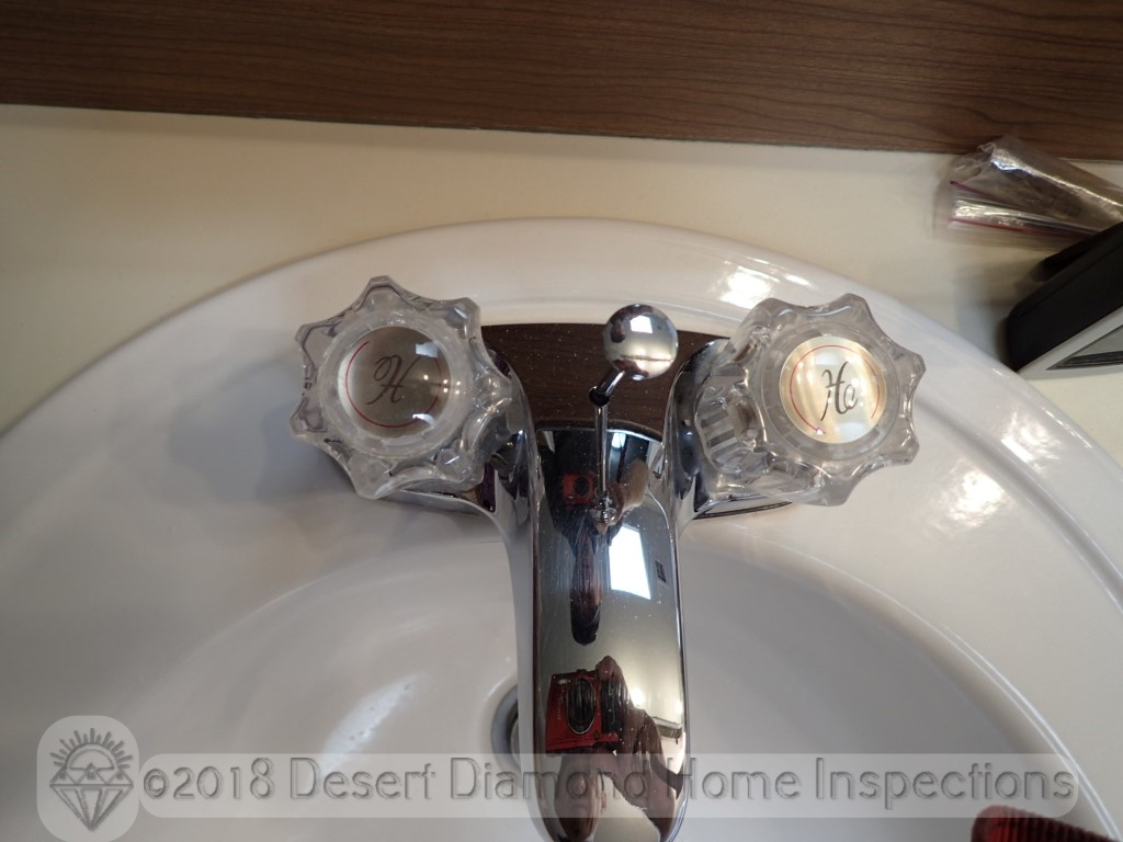 Only people living in the desert will understand why the markings on the faucet are accurate.