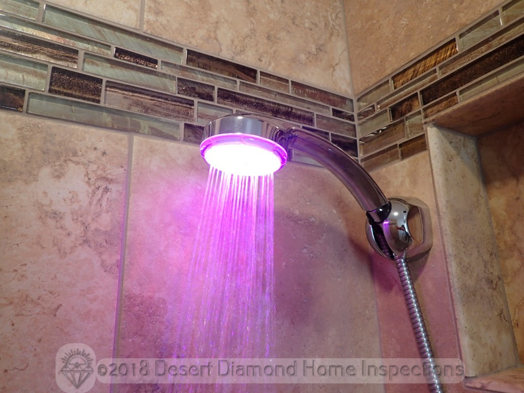 Shower head with built-in disco light show for extra shower ambiance