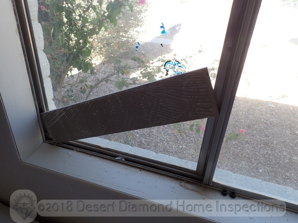 If you don't have a dowel handy to secure the window track, in a pinch a piece of tile will do just fine.