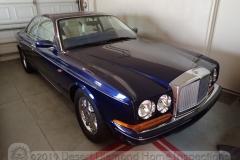 A shiny blue Bentley.