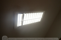 Plantation shutter mounted on ceiling at skylight