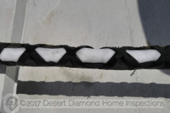 This photo was taken in July on a Tucson roof in direct sun light with an ambient temperature of well over 100 degrees. Yes, that is a thick layer of ice on the refrigerant lines of the AC.