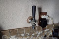 This convenient beer tap at the kitchen counter leads to the Kegerator in the garage on the other side of the well