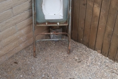 We have no idea what lead somebody to construct this contraption found in a backyard. We hope the poop is from the resident pooch.