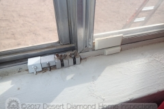 This home owner takes their security serious: an alarm sensor plus four window locks - on a single-pane window