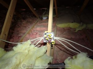 Exposed electrical splices in attic